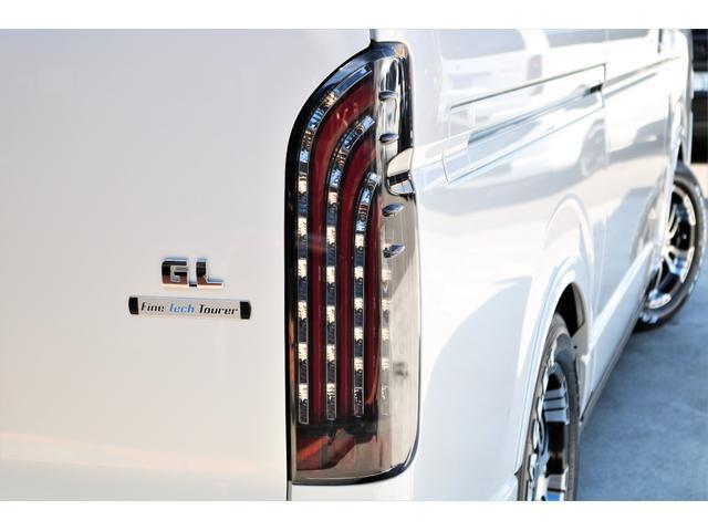 GL ロング ファインテックツアラー 4WD 寒冷地仕様 キャプテンシート トリプルモニター 1.15ローダウン 17インチAW ホワイトレターナスカータイヤ LEDテール ブラックレザー調シートカバー 黒木目インテリア(25枚目)