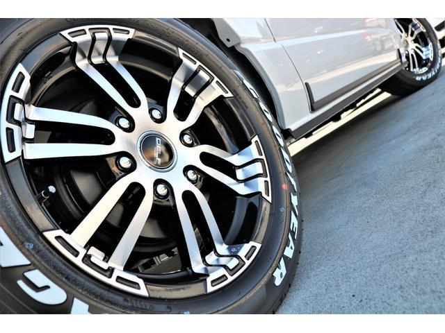 GL ロング ファインテックツアラー 4WD 寒冷地仕様 キャプテンシート トリプルモニター 1.15ローダウン 17インチAW ホワイトレターナスカータイヤ LEDテール ブラックレザー調シートカバー 黒木目インテリア(28枚目)