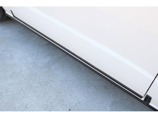GL ロング ファインテックツアラー 4WD 寒冷地仕様 キャプテンシート トリプルモニター 1.15ローダウン 17インチAW ホワイトレターナスカータイヤ LEDテール ブラックレザー調シートカバー 黒木目インテリア(29枚目)
