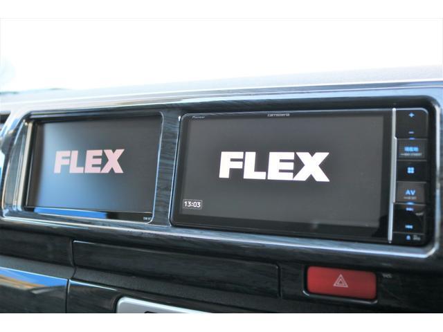 GL ロング ファインテックツアラー 4WD 寒冷地仕様 キャプテンシート トリプルモニター 1.15ローダウン 17インチAW ホワイトレターナスカータイヤ LEDテール ブラックレザー調シートカバー 黒木目インテリア(30枚目)