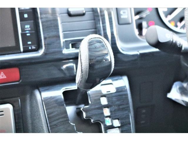 GL ロング ファインテックツアラー 4WD 寒冷地仕様 キャプテンシート トリプルモニター 1.15ローダウン 17インチAW ホワイトレターナスカータイヤ LEDテール ブラックレザー調シートカバー 黒木目インテリア(38枚目)