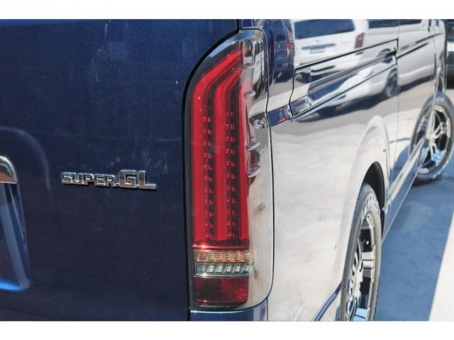 ロングスーパーGL 2WD 4型 TSS付き ダークブルーM フロントスポイラー 17インチAW ホワイトレタータイヤ 1.5ローダウン アルティメットLEDテール シートカバー SDナビ(18枚目)