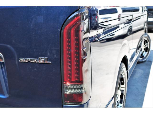 ロングスーパーGL 2WD 4型 TSS付き ダークブルーM フロントスポイラー 17インチAW ホワイトレタータイヤ 1.5ローダウン アルティメットLEDテール シートカバー SDナビ(33枚目)