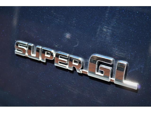 ロングスーパーGL 2WD 4型 TSS付き ダークブルーM フロントスポイラー 17インチAW ホワイトレタータイヤ 1.5ローダウン アルティメットLEDテール シートカバー SDナビ(34枚目)