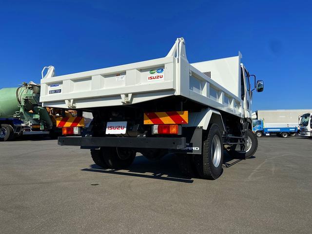 ダンプ 6MT・新明和強化1方開・積載3.750kg・助手席側電格ミラー・距離14.000km・取説・保証書(2枚目)