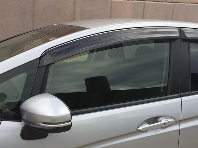 ハイブリッド ホンダセンシング ホンダセンシング  社外メモリナビ アイドリングストップ ETC プラズマクラスター付オートエアコン 横滑り防止装置 プッシュスタート スマートキー 電動格納ミラー フロアマット ドアバイザー(38枚目)