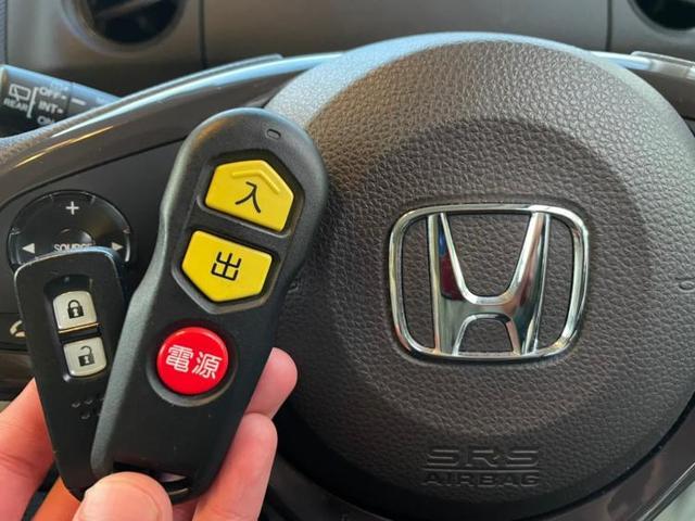 G・スロープホンダセンシング 社外 メモリーナビ/ETC/EBD付ABS/横滑り防止装置/アイドリングストップ/TV/エアバッグ 運転席/エアバッグ 助手席/パワーウインドウ/キーレスエントリー/オートエアコン リフトアップ(9枚目)