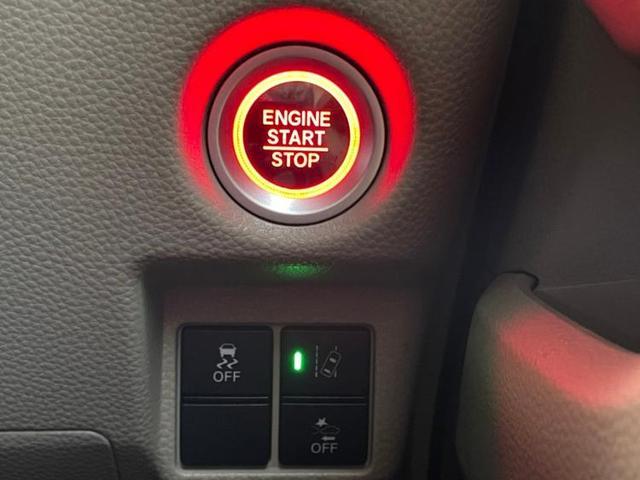 G・スロープホンダセンシング 社外 メモリーナビ/ETC/EBD付ABS/横滑り防止装置/アイドリングストップ/TV/エアバッグ 運転席/エアバッグ 助手席/パワーウインドウ/キーレスエントリー/オートエアコン リフトアップ(10枚目)