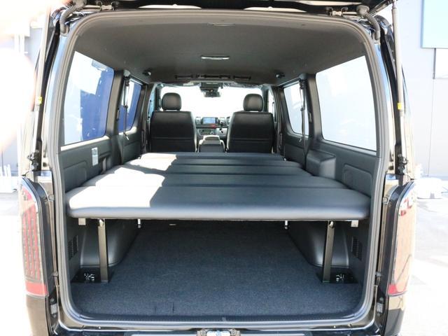 スーパーGL ダークプライムII 未登録新車6型ハイエースバン2WD スーパーGLダークプライム2特別仕様車 カスタムパッケージ ブラック黒 レジャーキャンプアウトドア車中泊ベッドキット 積載 SDフルセグナビ パノラミックビュー(70枚目)