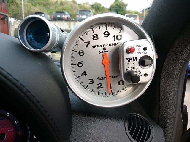 ツーリズモ 赤レザーシート キセノンヘッドライト パドルシフト 純正17インチアルミホイール 7インチタッチパネルU-Connect AutoMeter レコードモンツァマフラー(32枚目)