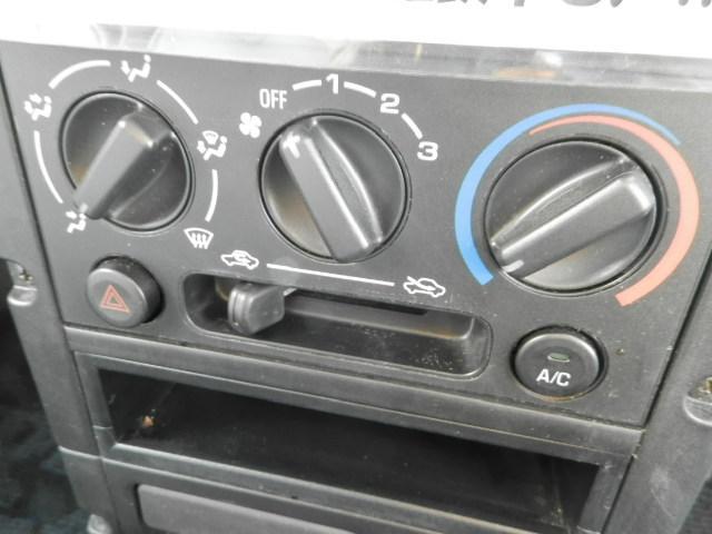 ターボG ターボ4WD5速マニュアル純正13インチアルミホイール電動格納ミラーフォグランプ衝突安全ボディーフルフラットシートWエアバックABSサイドバイザーベンチシート純正フロアマットフル装備パワーステアリング(10枚目)