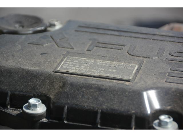 3軸 ベッド ミキサー車 カヤバ 8.9立米 電動ホッパ 6速MT 2デフ 水タンク 左電動格納ミラー キャブラダー フォグランプ ミラーヒーター 坂道発進補助 デフロック ETC チョーク タコグラフ アドブルー(30枚目)