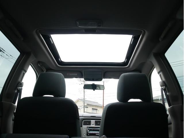 XT 1年保証付 5速MT サンルーフ EJ20ターボ 4WD ハーフレザーシート MOMOステ オートエアコン 純正16AW ルーフスポイラー 電動格納ミラー キーレス HID(12枚目)