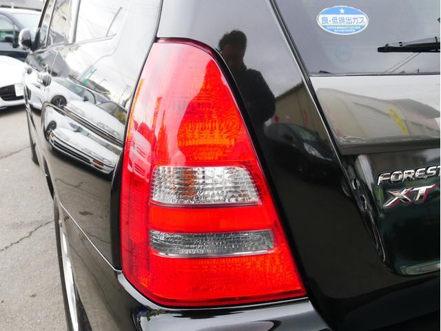 XT 1年保証付 5速MT サンルーフ EJ20ターボ 4WD ハーフレザーシート MOMOステ オートエアコン 純正16AW ルーフスポイラー 電動格納ミラー キーレス HID(77枚目)