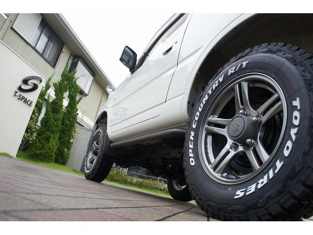 XC 9型 GIGEAR2インチリフトアップ・前後バンパー・サイドステップ・砲弾型マフラー・ラテラルロッド・オープンカントリーホワイトレターR/Tタイヤ!!オプション多数あり!!(11枚目)
