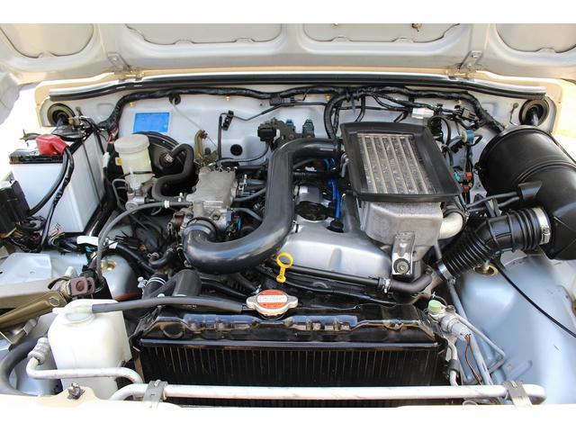 ランドベンチャー 4WD ターボ JA22最終2型 2インチリフトアップ足廻り マットブラック16インチAW GEOLANDAR.A/Tタイヤ サイドステップ カリフォルニアミラー 背面タイヤレス サンドベージュ色替車(18枚目)