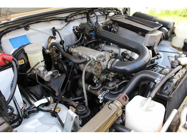 ランドベンチャー 4WD ターボ JA22最終2型 2インチリフトアップ足廻り マットブラック16インチAW GEOLANDAR.A/Tタイヤ サイドステップ カリフォルニアミラー 背面タイヤレス サンドベージュ色替車(79枚目)