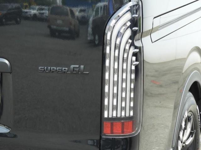 スーパーGL ダークプライムII 新車/2800クリーンディーゼル ベットキット 両側自動ドア ブラックエディション インナーブラックライト マッドブラックカスタム パナソニックフルセグナビ/ETC 新作カーボン調オーバーフェンダー(18枚目)