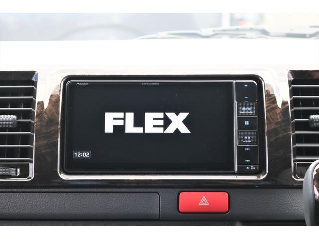 GL フレックスオリジナル内装架装Ver1木目柄フロア床張りフルセグ7インチナビフリップダウンモニターHDMIソケットUSB充電ソケットシートカバーローダウンアルミホイールグッドイヤーナスカータイヤ(32枚目)