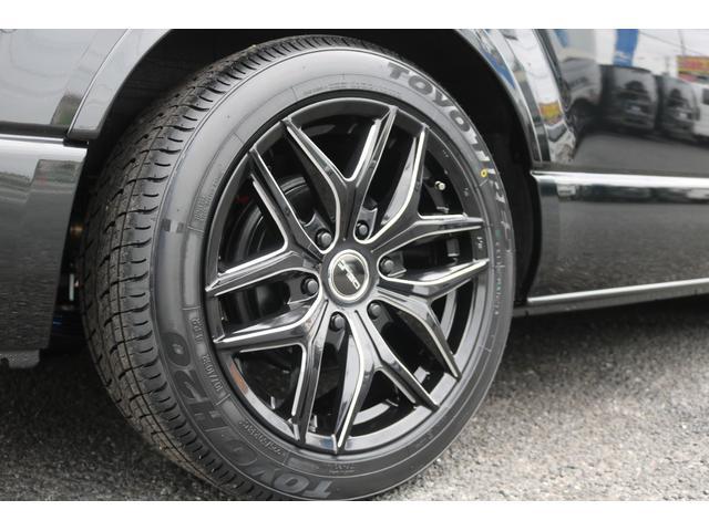 GL ロング 新車ハイエースワゴンGLブラックスシーリーズアルパインフルセグ11インチSDナビHDMIソケットミラーリングDELF01アルミホイールGOODYEARナスカータイヤ18インチオリジナルシートカバー(23枚目)