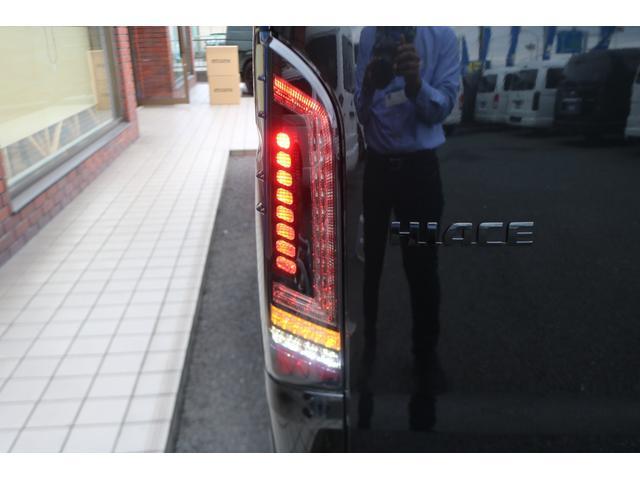 GL ロング 新車ハイエースワゴンGLブラックスシーリーズアルパインフルセグ11インチSDナビHDMIソケットミラーリングDELF01アルミホイールGOODYEARナスカータイヤ18インチオリジナルシートカバー(29枚目)
