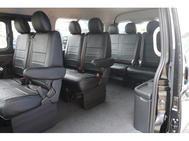 GL ロング 新車ハイエースワゴンGLブラックスシーリーズアルパインフルセグ11インチSDナビHDMIソケットミラーリングDELF01アルミホイールGOODYEARナスカータイヤ18インチオリジナルシートカバー(34枚目)