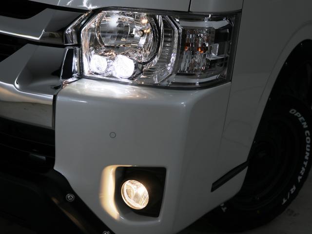 GL 10人乗り3ナンバー登録 ガソリン4WD 寒冷地仕様 内装アレンジVer1デニム バンパーガード オーバーフェンダー 16インチAW ナビ ETC 後席モニター ベッド テーブル 床張り(9枚目)