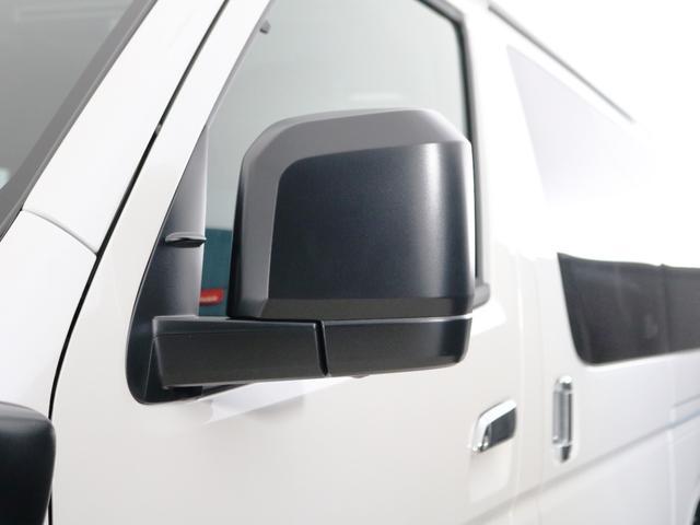 GL 10人乗り3ナンバー登録 ガソリン4WD 寒冷地仕様 内装アレンジVer1デニム バンパーガード オーバーフェンダー 16インチAW ナビ ETC 後席モニター ベッド テーブル 床張り(12枚目)