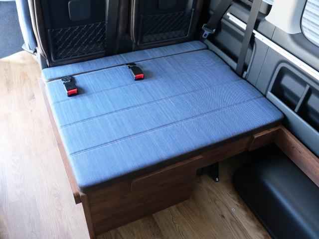 GL 10人乗り3ナンバー登録 ガソリン4WD 寒冷地仕様 内装アレンジVer1デニム バンパーガード オーバーフェンダー 16インチAW ナビ ETC 後席モニター ベッド テーブル 床張り(34枚目)