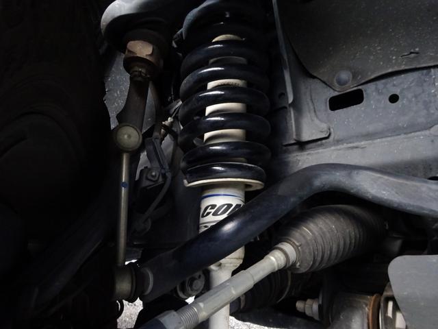 TX 4WD・リフトアップ・FUEL17AW・ミッキートンプソンホワイトレターT・OPルーフレール・マッドブラックグリル・LED・革調シート・ナビ・地デジTV・バックカメラ・ETC・トノカバー・走行2万キロ(5枚目)