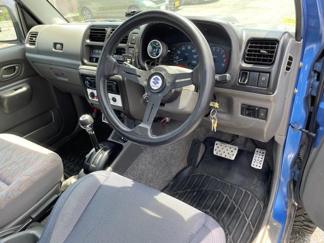 XC 4WD インタークーラーターボ リフトアップ 社外マフラー 社外シート ロールバー オーバーフェンダー 社外アルミ 社外ハンドル ETC 構造変更届出 普通車登録 追加メーター(43枚目)
