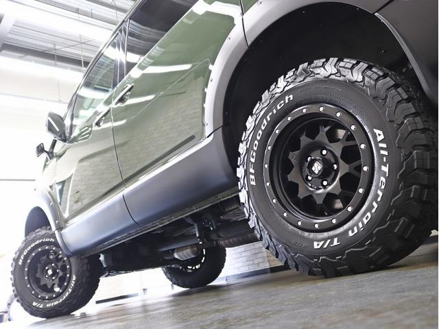 G パワーパッケージ 1オーナー 両側電動パワーS KADDISエアロボンネット 4インチリフトアップ JAOSオーバーフェンダー 16インチ新品アルミホイール LEDイカリングヘッドライト 8人乗り 4WD(15枚目)