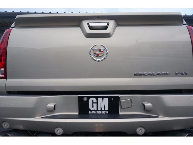 キャデラック キャデラック エスカレードEXT ガルウィングリフトアップFUEL20AWマフラーHDDナビ