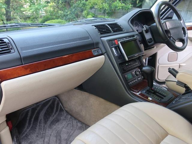 4.0SE 4WD ナビ 禁煙車 革シート クルコン AT AW コンパクトカー Dグリーン 5名乗り パワーウィンドウ(5枚目)