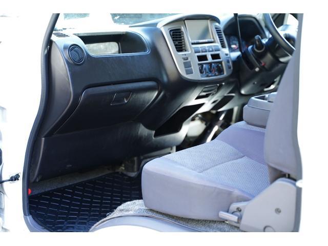 ロングDX ガソリン/2.000cc/5速AT/6人乗/両側スライドドア/スライドサイドウィンドウ/純正キーレス/日産純正ナビMS110-A/地デジ/ルーフキャリア/運転席パワーウィンドウ/運転席エアーバック(70枚目)