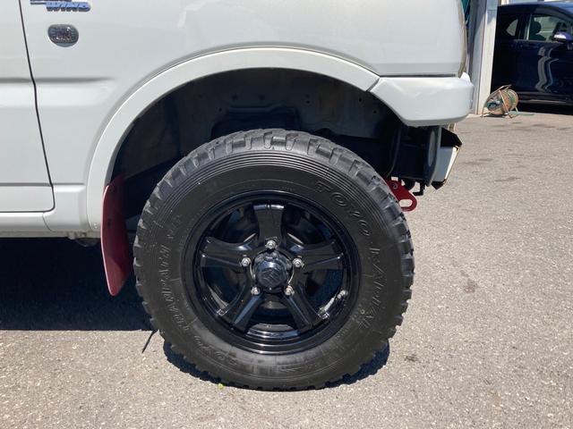 ワイルドウインド リフトアップ キーレス 5速マニュアル フル装備 4WD アルミホイール ETC 電動格納ミラー 社外パーツ 背面タイヤ ルーフレール(26枚目)