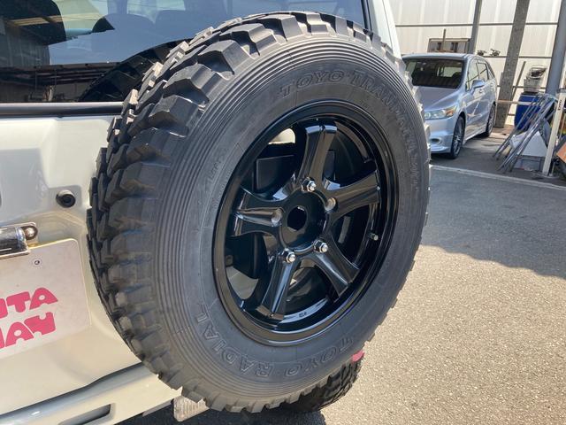 ワイルドウインド リフトアップ キーレス 5速マニュアル フル装備 4WD アルミホイール ETC 電動格納ミラー 社外パーツ 背面タイヤ ルーフレール(28枚目)