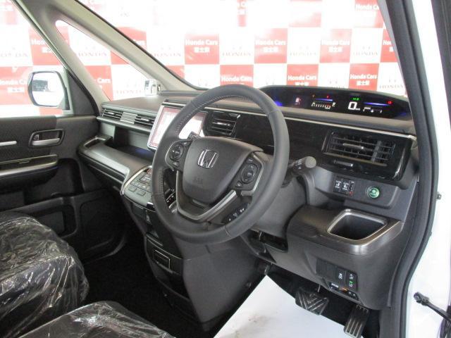 スパーダ・クールスピリット ホンダセンシング 登録済未使用車 ギャザズ9インチナビ リアカメラ ETC フルセグ CD録音 DVD再生 Bluetooth接続 シートヒーター 3ゾーンエアコン LEDヘッドライト 追突軽減ブレーキ 新車保証継承(12枚目)