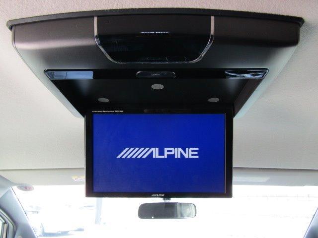 ZS 1年保証付 エアロ 後席フリップダウンモニター 両側パワースライドドア LEDヘッドライト SDナビ 7人乗 Bluetooth スマートキー バックカメラ オートライト ローダウン CD・DVD再生(9枚目)