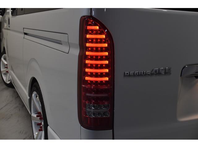ロングスーパーGL 自社ユーザー買取車・ES18インチAW・フロントリップッスポイラー・リアスムージングバンパー・シートカバー・ケンウッドSDナビゲーション・HIDヘッドライト・ホワイトパール・AC100V電源(24枚目)