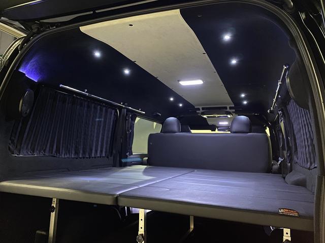スーパーGL ダークプライム 自社ユーザー様買取・ワンオーナー・TRD16インチAW・3ナンバー乗用車登録・2インチリフトアップ・床フローリング・フェリソニン全面施工・マルチウェイベットキット・内装張り替え・スキッドバー・クルスロ(54枚目)