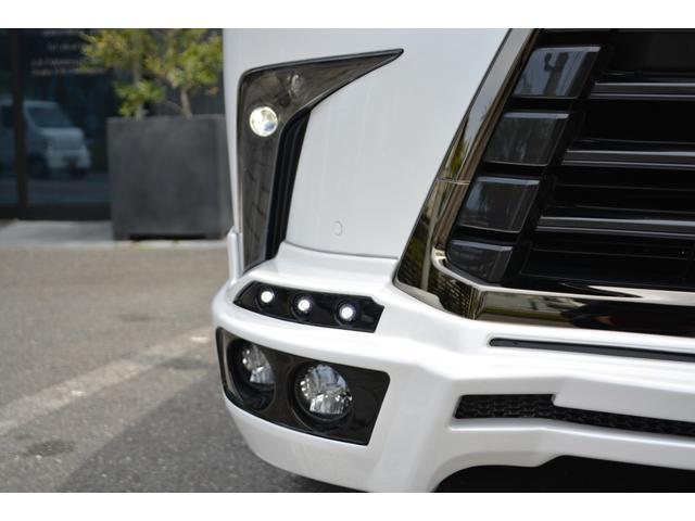 LX570 ZEUS新車カスタムコンプリートカー・エアロ3点・4灯フォグ・22インチアルミ・4本出マフラー・マークレビンソン・リアエンターテイメントシステム・置くだけ充電(11枚目)