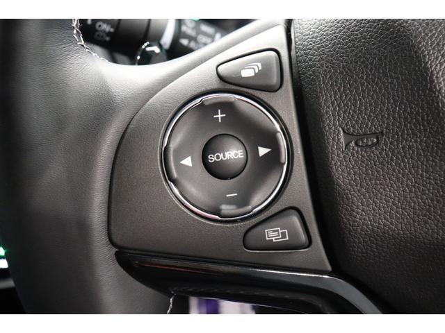 ハイブリッドZ・ホンダセンシング 衝突被害軽減システム 純正メモリーナビ 盗難防止システム ステアリングスイッチ バックカメラ ドライブレコーダー LEDヘッドランプ レーンアシスト オートライト ETC フルセグTV AW CD(9枚目)