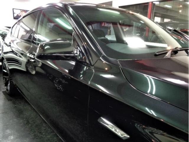535iグランツーリスモ 黒革ウッドインテリアガラスサンルーフフルセグナビTVバックカメラFリップスポイラーローダウンサス20インチAW電動リアゲートクルーズコントロールパワーシートシートヒーター直6ターボ306PS8速AT(12枚目)