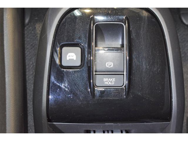 スパーダハイブリッド G ホンダセンシング フルセグ メモリーナビ DVD再生 ミュージックプレイヤー接続可 バックカメラ 衝突被害軽減システム ETC 両側電動スライド LEDヘッドランプ 乗車定員7人 3列シート フルエアロ(28枚目)