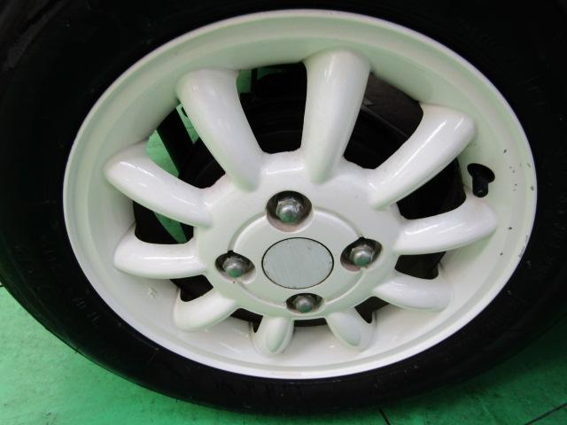 L ワンオーナー キーレス ヘッドライトレベライザー ABS 電動格納ミラー ベンチシート バニティミラー シートリフター 13インチアルミホイール プライバシーガラス パワーウィンドウ Wエアバック(25枚目)
