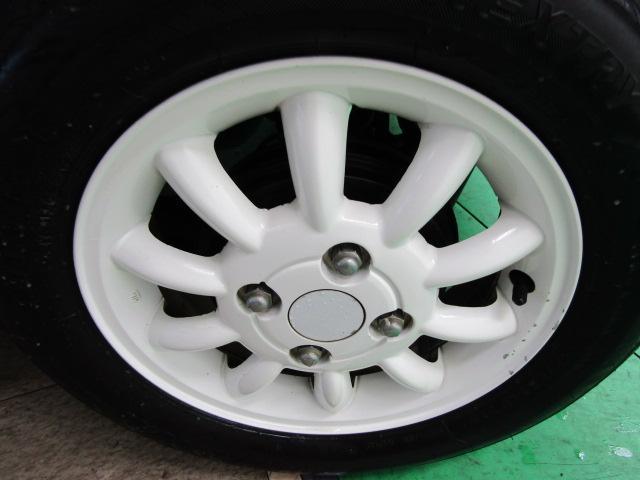 L ワンオーナー キーレス ヘッドライトレベライザー ABS 電動格納ミラー ベンチシート バニティミラー シートリフター 13インチアルミホイール プライバシーガラス パワーウィンドウ Wエアバック(26枚目)