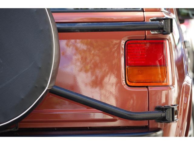 背面タイヤカバーは、納車時に、日産純正のタイヤカバーを装着致します。納車までの作業内容なども、記載しております当店ホームページに遊びに来て下さい。http://www.e-rasheen.com/