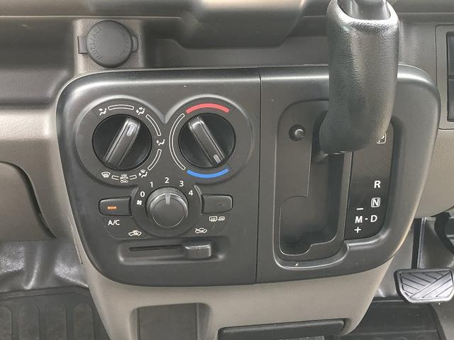 PCリミテッド 切替式4WD リフトアップ 新品MCG15インチアルミ 新品オープンカントリータイヤ ナビTV ETC キーレス ハイルーフ 禁煙車 5速AT(22枚目)