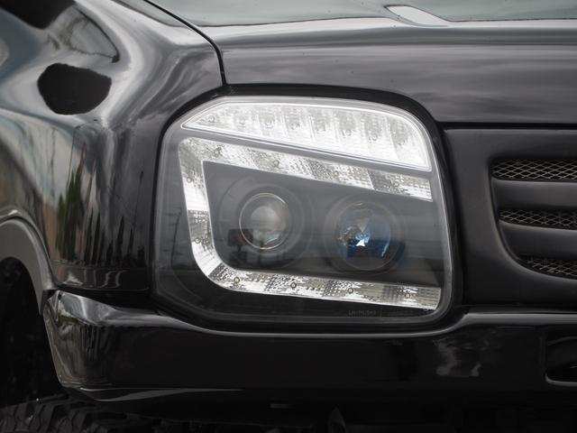 XC リフトアップ 16AW GEOLANDAR M/Tタイヤ 社外マフラー 社外ヘッドライト LEDテール 社外ステアリング ナビ DVD シートカバー(8枚目)